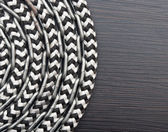 Metal chain and ship rope on dark wooden background — Stock Photo
