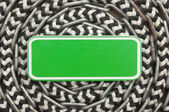 Marine roll ropes and chain with blank green sign on wooden back — Stock Photo