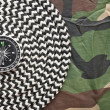 Compass and rope on a camouflage background — Foto Stock