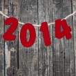 Stock Photo: 2014 New Year hanging rope on old wood background.