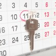 A house key on a calendar background, paying your mortgage on ti — Stock Photo #35378625