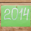 Hand writing text  2014 new year on wooden wall. The symbol of t — Stock Photo