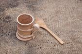 Wooden utensils on old worn burlap — Stock Photo