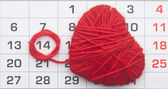 Calendar, by February 14 and shape red heart. — Stock Photo