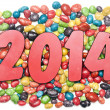 New year 2014 on sweet candies background — Stock Photo