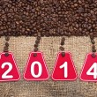 2014 text and coffee beans on a old burlap background — Stockfoto
