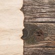 Stock Photo: Burned old paper on border wood background