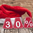 30 percent with santa hat on old wooden background — Stock Photo #36078395
