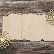 Old paper with golden snowflakes — Stock Photo
