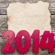 2014 New Year holiday background with old crumpled paper sheet  — Stock Photo