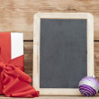 White boxs, red ribbon, christmas ball and blank small blackboar — Stock Photo