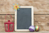 Christmas decoration with framed blackboard on wooden background — Stock Photo