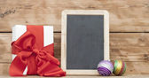 White boxs, red ribbon, christmas ball and blank small blackboar — Foto de Stock