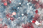 Background from red and blue christmas tinsel — Stock Photo