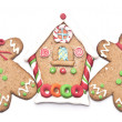 Gingerbread house with two gingerbread mans on white background — Stock Photo