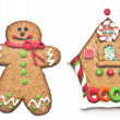Gingerbread house with gingerbread man on white background — Stock Photo
