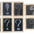 Question and exclamation marks - white chalk drawing on small bl — Stockfoto