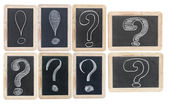 Question and exclamation marks - white chalk drawing on small bl — Stock Photo