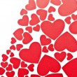 Red hearts background on white with copy space — Stock Photo