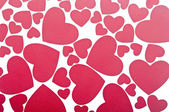 Red hearts background on white — Stockfoto