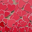 Tiny red hearts background — Stock Photo