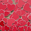 Stock Photo: Tiny red hearts background