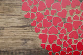 Valentine's day hearts over grunge wood — Stock Photo