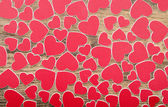 Tiny red hearts on wooden background — Stock Photo