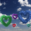Heart-shaped colorful baloons in the sky, the symbols of love — Stock Photo