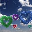 Heart-shaped colorful baloons in the sky, the symbols of love — Stock Photo #39384197