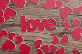 Word ''love'' on a old wood planks. — Stock Photo