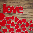 Word love with heart shaped valentines day holiday background wi — Stock Photo