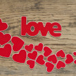 Stock Photo: Word love with heart shaped valentines day holiday background wi