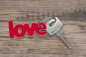 Key to love concept with word written on label or tag — Stock Photo