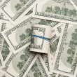 Background with money american hundred dollar bills and roll of — Stock Photo