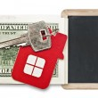 House keys and blank blackboard over the hundred dollar banknote — Stock Photo #42035691