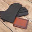 Black man's leather gloves with wallet — Stock Photo #42038709