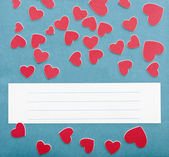 Small hearts and blue wallpaper texture with copy space for your — Stock Photo