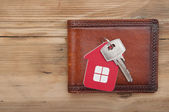 Wallet and key on wood background  — Stock Photo