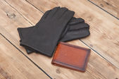 Black man's leather gloves with wallet — Stock Photo