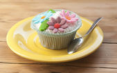 Beautiful cupcakes on vintage wooden background — Stock Photo