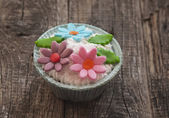 Beautiful muffins decorated with spring flower on vintage wooden — Stock Photo