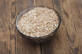 Pale malt barley in a glass bowl, an ingredient for beer.  — Stock Photo
