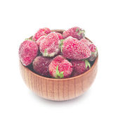 Frozen strawberries in a wooden bowl on white background  — Stock Photo