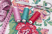 Cross-stitch set: colorful threads and canvas  — Stok fotoğraf