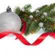 Stock Photo: Isolated Silver Christmas ball with Red Ribbon and Green Pine