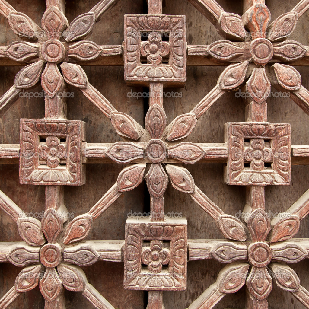 Carved wooden latticework with pattern of flowers and squares.  — Stock Photo #13713347
