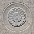 Stock Photo: Carved Flower design on Stone