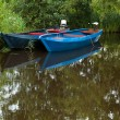 Stock Photo: Two Blue Boats on lake