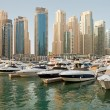 Luxurious Yachts and Boats in Front of Dubai Marina Skyscrapers — Stock Photo